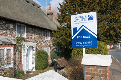 House with For Sale sign outside