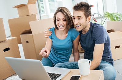 Couple looking at guide on selling a house