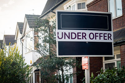 under offer sign outside a house