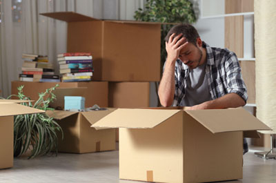frustrated man with packing box